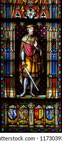 Bruges, Belgium - August 18, 2018: Stained Glass in the Basilica of the Holy Blood in Bruges, Belgium, depicting Crusader King Baldwin III of Jerusalem.