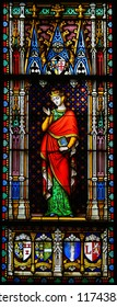 Bruges, Belgium - August 18, 2018: Stained Glass in the Basilica of the Holy Blood in Bruges, Belgium, depicting Countess Sibylla of Anjou, a countess consort of Flanders in the 12th Century.