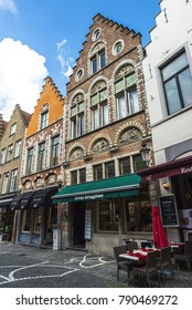 Bruges, Belgium, - August 31, 2017: Street with bars and restaurants in the medieval city of Bruges, Belgium