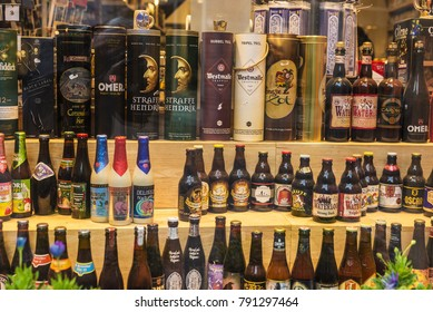 Bruges, Belgium, - August 31, 2017: Showcase of a beer and liqueur store in an old historic center of the medieval city of Bruges, Belgium