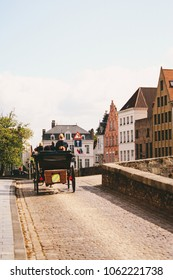 BRUGES, BELGIUM - CIRCA AUGUST 2009: Horse carriage taking tourists around the old town of Bruges, Belgium