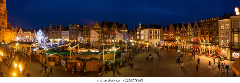 Bruges, Belgium - december 14, 2018: Central Bruges Market Square by night decorated at Christmas. - Image