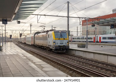 Bruges, Belgium - December 29, 2014: Passenger train near the platform of the railway station in the city of Bruges.
