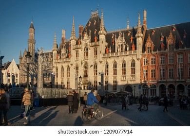 Bruges, Belgium – December 9, 2011: Afternoon colorful view of the Town Hall façade at Marktplatz