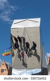 BRUGES, BELGIUM/ EUROPE - SEPTEMBER 26:Split mirror of people in Market Square Bruges West Flanders in Belgium on September 26, 2015. Unidentified people.
