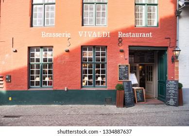 BRUGES, BELGIUM - FEBRUARY 17, 2019: Vivaldi restaurant in a house on a popular city street.