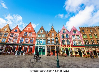 BRUGES, BELGIUM- FEBRUARY 28, 2017: Unidentified tourists and locals visit The Markt ( Market Square). The famous square of Bruges with historical highlights and colourful buildings.