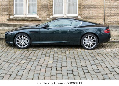 BRUGES, BELGIUM – FEBRUARY 5, 2017: Aston Martin car parked in front of an old house.