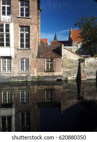 Bruges Belgium historic houses with tile roof on canal Europe