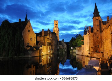 Bruges, Belgium. Image with Rozenhoedkaai in Brugge, Dijver river canal twilight and Belfort (Belfry) tower.