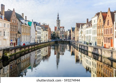 BRUGES, BELGIUM - JANUARY 29, 2017: Reflection of church in Jan Van Eyckplein in the UNESCO World Heritage Old Town of Bruges, Belgium