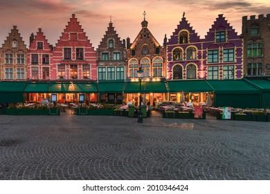 Bruges, Belgium, Jul 2021: View of old houses in Markt, medieval market square of Bruges in Flanders. Belgium landmark.
