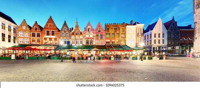 Bruges, Belgium - July 15, 2017: Bruges - Bruges  in the Grote Markt in the city centre in Bruges, Belgium. Medieval stone crockets and finials line the bell tower.