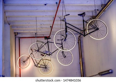 Bruges, Belgium - July 23, 2019: Bicycles hanging from the ceiling at an entrance to a bike parkade in Bruges Belgium