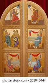BRUGES, BELGIUM - JUNE 13, 2014: The door to presbytery with the icons of the four evengelists and the Annunciation scene in st. Constanstine and Helena orthodox church (2007 - 2008).