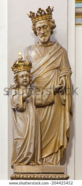 BRUGES, BELGIUM - JUNE 13, 2014: The carved statue of st. Joseph with the crown in Karmelietenkerk (Carmelites church)