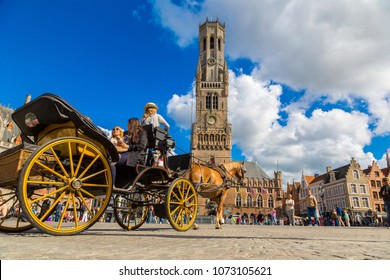 BRUGES, BELGIUM - JUNE 14, 2016: Horse carriage in the Market square in Bruges in a beautiful summer day, Belgium on June 14, 2016