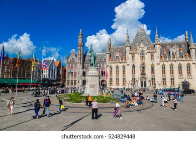 BRUGES, BELGIUM - JUNE 14, 2016: Panoramic view of Market Square in Bruges in a beautiful summer day, Belgium on June 14, 2016