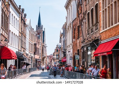 BRUGES, BELGIUM - JUNE 23, 2019: Old city with people walking and bicyclists