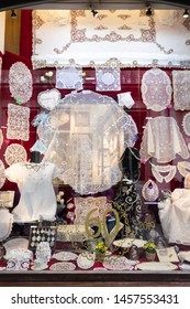 BRUGES, BELGIUM - MAY 02, 2019: Traditional and famous Belgian lace in a shop window, Brussels, Belgium