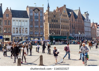 BRUGES, BELGIUM: - MAY 4 2018: View to Great Market Square with people. Blue sky and buildings in the background.