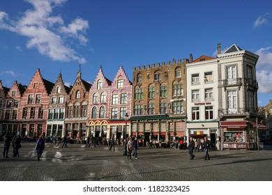 Bruges / Belgium - November 17, 2017; People walking at Market Square that is the center of Bruges in Belgium.