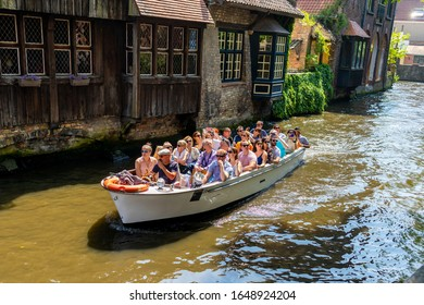 BRUGES, BELGIUM- OCT. 16, 2019 Channels of Bruges. The tourist boats that cross the canals of the city are one of its most requested attractions and are used daily by thousands of visitors.