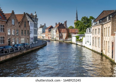 BRUGES, BELGIUM- OCT. 16, 2019 Panoramic of the canals and terraces of Bruges. Drinking a typical Belgian beer by the canal is one of the main attractions of the city