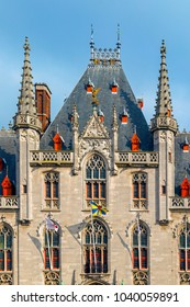 BRUGES, BELGIUM - OCTOBER 13, 2015: Front view of The Provinciaal Hof - Province Court- a Neogothical building on the market place in Bruges, Belgium.