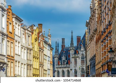 BRUGES, BELGIUM - OCTOBER 13, 2015: View of one street with old neogothical buildings and the Provinciaal Hof - Province Court - at the end of street.