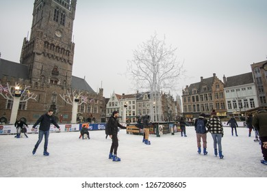 BRUGES BELGIUM ON NOVEMBER 25, 2018: Christmas square Grote Markt with Christmas market and ice rink  in Bruges.