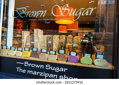 Bruges, Belgium - September 1, 2017: Display of a marzipan shop full of chocolates with fruit flavors in the medieval city of Bruges, Belgium
