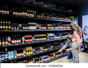 BRUGES, BELGIUM - SEPTEMBER 10, 2014: Very large choice of beers and liquors at alcohol store in center of Bruges, Belgium