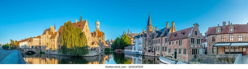 Bruges Belgium vintage stone houses and bridge over canal ancient medieval street picturesque landscape, Bruges, Belgium.
