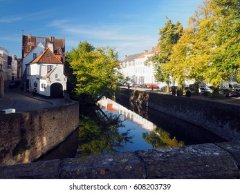 BRUGES, BELGIUM-SEPTEMBER 29:  Historic houses are seen in De Rode Steen (Red Brick-Red Stone) on canal in medieval Brugge Bruges, Belgium, Europe with some tourists on September 29, 2016.