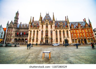 Bruges (Brugge), Belgium - March 22, 2018 - Street view of the Province Court (Provinciaal Hof), a Neogothical building on the Markt of Bruges (Market Square)