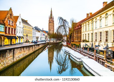 Bruges (Brugge), Belgium - March 22, 2018 - Street view of The Church of Our Lady (Onze-Lieve-Vrouwekerk) and Dijver canal in the old town of Bruges