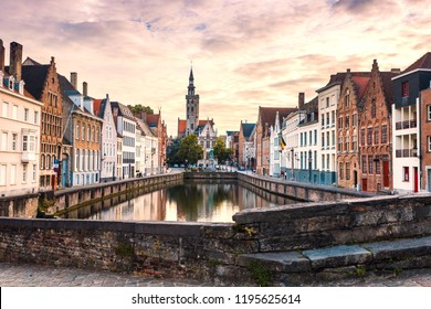 Bruges cityscape. Old Brugge town famous destination in Europe. Brugge in evening with colorful sky. Ancient buildings at the water canal. Bruges skyline.