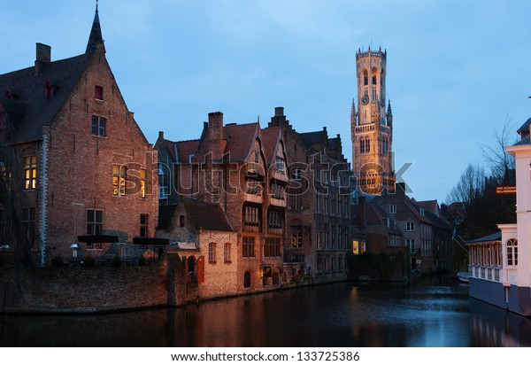 Bruges historic centre at Night. The classic view from the Rozenhoedkaai. Belgium