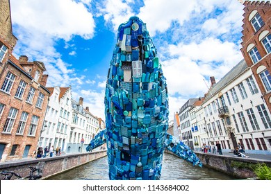 BRUGES,BELGIUM-JUNE 16 : Skyscraper or the Bruges Whale made of waste, collected from the plastic soup that floats on the seas and oceans of the world.