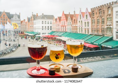 Brugge, APR 28: Enjoying beer and chocolate at Market Place on APR 28, 2018 at Brugge, Beligum