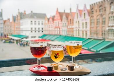 Brugge, APR 28: Enjoying beer and chocolate at Market Place on APR 28, 2018 at Brugge, Beligum