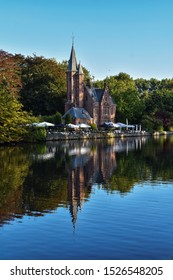 Brugge, Belgium - 10 Sep 2019: Lake  Minnewater and  Minnewater restaurant. The picture was taken from the opposite side of the lake