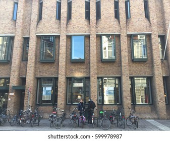 BRUGGE, BELGIUM - 4 DECEMBER 2016 : People come to use city library in Brugge