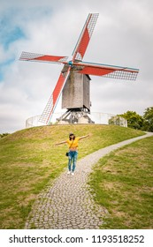 Brugge Belgium, colorful house at the old city of Brugge , young woman free in the city by the old windmill