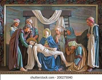 BRUGGE, BELGIUM - JUNE 13, 2014: Relief of Deposition of the cross in st. Giles (Sint Gilliskerk) as part of the Passion of Christ cycle.