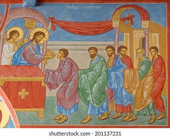 BRUGGE, BELGIUM - JUNE 13, 2014: Fresco of the Communion of the apostle scene in st. Constanstine and Helena orthodx church (2007 - 2008).