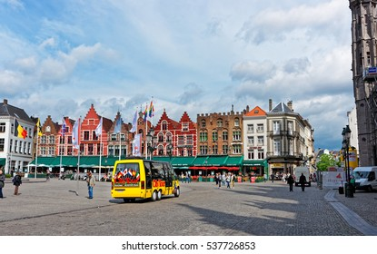 Brugge, Belgium - May 10, 2012: Grote Markt, or Market Square in the medieval old town of Brugge, Belgium. People on the background