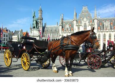 Brugge. Horse-driven cab.