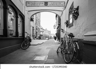 Brugge/Belgium; January 23rd 2020: Three bicycles in a passageway in Brugge